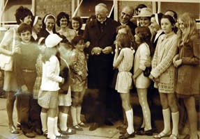 Cardinal Heenan with parishioners