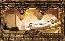 The body of Saint John Mary Vianney wearing a wax mask, found to be incorrupt by the Catholic Church. The body is entombed above the main altar in the Basilica at Ars, France.