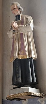 Statue of Jean-Marie Vianney in the church of a small village in France.