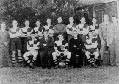 1949: Fr. Bryant with Youth Club Football XI, Willesden League Champions